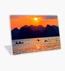 Halong Bay kayaks and sunset Laptop Skin