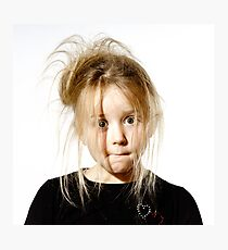 Disheveled preschooler girl with stupid face, isolated on white background Photographic Print