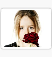 Cute little girl portrait with red rose, isolated on white background Sticker