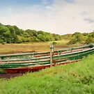 Moored red & green wooden rowing boat  by Hugh McKean