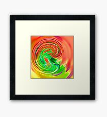 pink green purple and yellow drop of water Framed Print