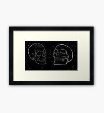 Space Skulls Framed Print
