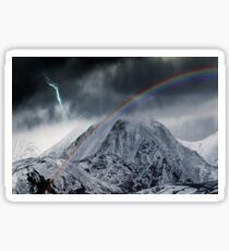 Rainbow and Lightning Bolt Over Snow Covered Mountains Sticker