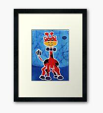 Red giraffe Framed Print