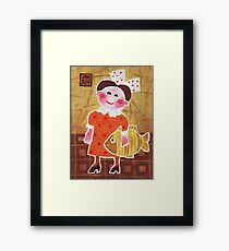 Girl with a fish Framed Print
