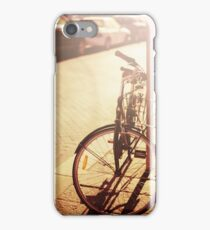 Bicycle resting at the street iPhone Case/Skin