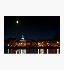 Building night lights and water reflection and moon Photographic Print