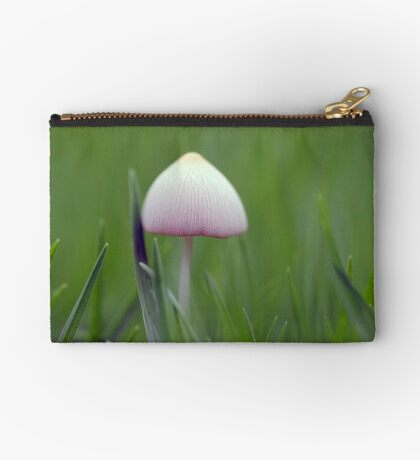 A tiny white mushroom hiding in the grass Studio Pouch