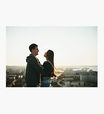 Young stylish couple hugging on the roof Photographic Print