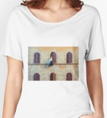 Italian building facade with arched windows with shutters and flag in Siena Women's Relaxed Fit T-Shirt