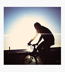 Man on bicycle riding at a coastline Photographic Print