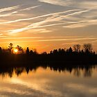 Painted By Airplanes - Reflecting On Contrails Streaked Sunrise Sky At The Lake by Georgia Mizuleva