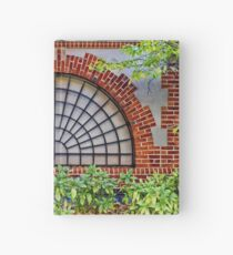Covered by a grate Hardcover Journal