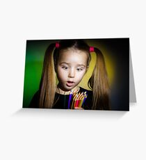 Cute little girl with colorful pencils, on yellow-green background Greeting Card