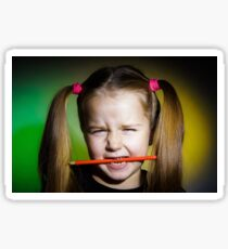 Cute little girl with colorful pencils, on yellow-green background Sticker