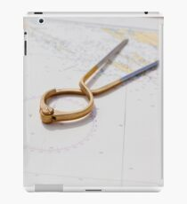 Pair of compasses for navigation on a sea map iPad Case/Skin