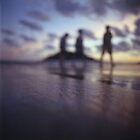 Chillout silhouette of people walking on beach dusk sunset evening sky Hasselblad medium format film analogue photo by edwardolive