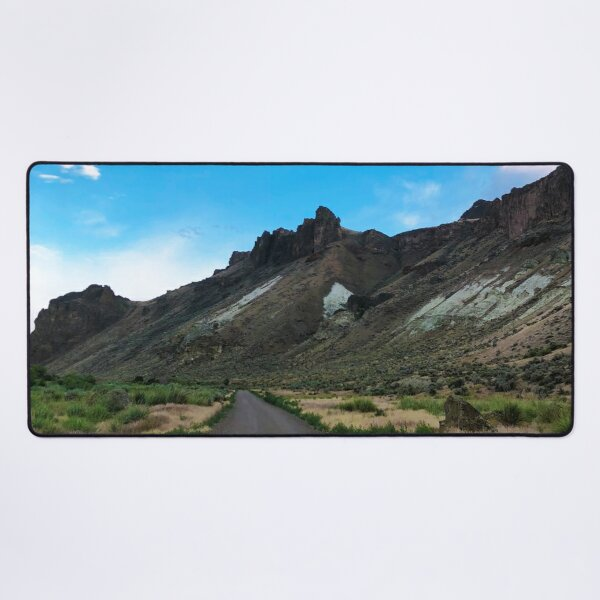 Adventure Amidst Rugged Crags and Azure Hues Desk Mat