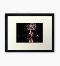 Bursting fireworks Framed Print