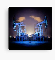Oil Rigs at night. Canvas Print