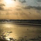 lone surfer on the winter waves by morrbyte