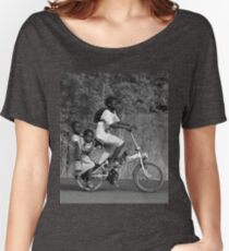 2 girls on the back a bicycle, coming from school, in Ghana, West Africa Women's Relaxed Fit T-Shirt