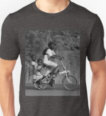 2 girls on the back a bicycle, coming from school, in Ghana, West Africa Unisex T-Shirt