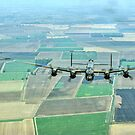 Escorted Lancaster over the Lincolnshire Fens by Colin Smedley