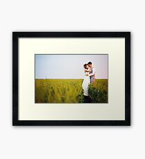 Happy young wedding couple kissing Framed Print
