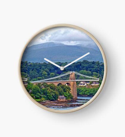 Snowdonia - seen from the Welsh village of Llanfairpwllgwyngyllgogerychwyrndrobwllllantysiliogogogoch, on the Island of Anglesey, Wales. Clock