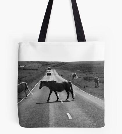 Horse crossing a road in Swansea`s Gower, protected area in Wales Tote Bag