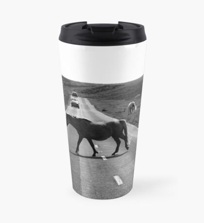 Horse crossing a road in Swansea`s Gower, protected area in Wales Travel Mug
