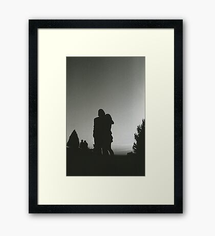 Wedding guests walking holding in silhouette at sunset in marriage party silver gelatin black and white 35mm negative analog film photo  Framed Print