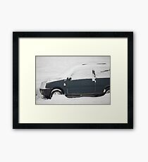 small car under snow Framed Print