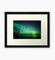 Northern lights over lake Framed Print