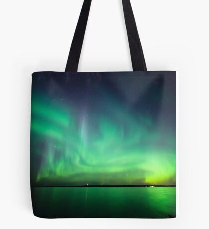 Northern lights over lake Tote Bag