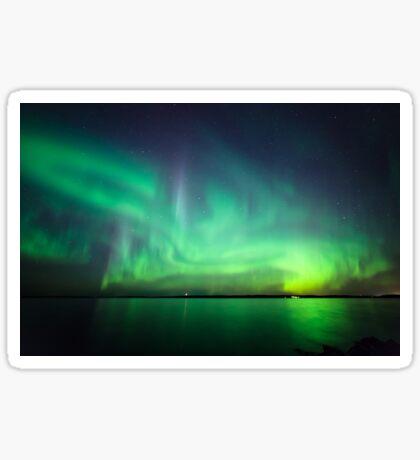 Northern lights over lake Sticker