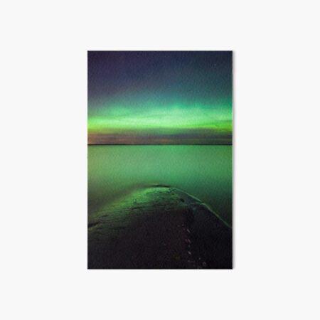 Northern lights glow over lake Art Board Print