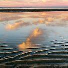 Ripples Meet Sky by Silken Photography