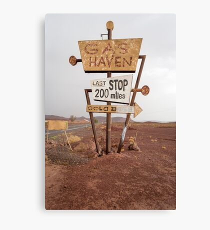Tall vintage gas sign standing in the desert Canvas Print