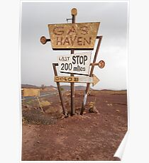 Tall vintage gas sign standing in the desert Poster