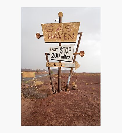 Tall vintage gas sign standing in the desert Photographic Print