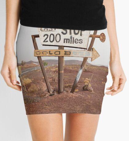 Tall vintage gas sign standing in the desert Mini Skirt