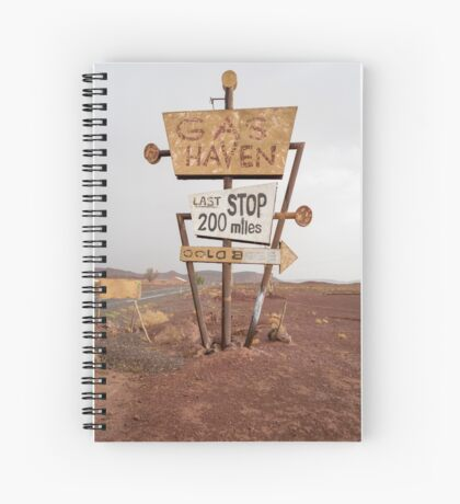 Tall vintage gas sign standing in the desert Spiral Notebook