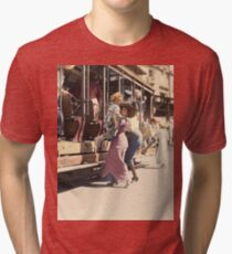 Mother helps her child off trolley in NYC — Colorized Tri-blend T-Shirt