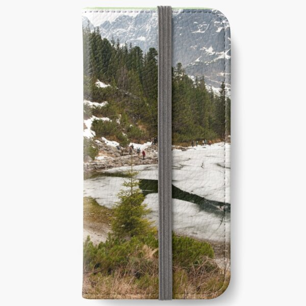 Tourists trek around Morskie Oko Lake iPhone Wallet