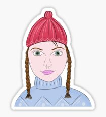 Cute Girl with Big Green Eyes and a Red Hat on a Snowy Scene with her Skis  Sticker