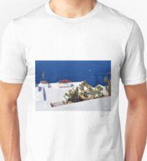 Caci on white terrace in Santorini, Greece T-Shirt