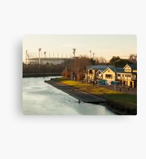 MCG with boat houses Canvas Print