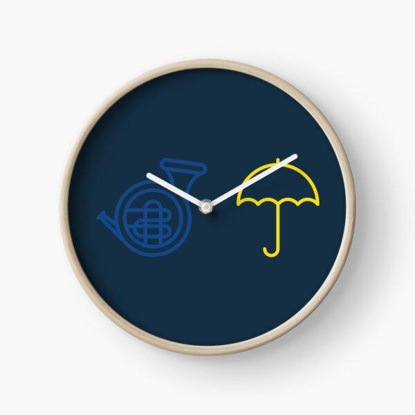 Blue French Horn Vs. Yellow Umbrella Clock